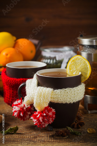 Fototapeta Cup with scarf with hot tea.