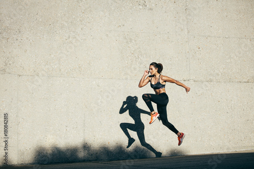 Poster Fitness woman doing cardio exercise