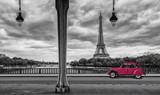 Eiffel Tower with vintage Car in Paris, seen from under the Bir Hakeim Bridge