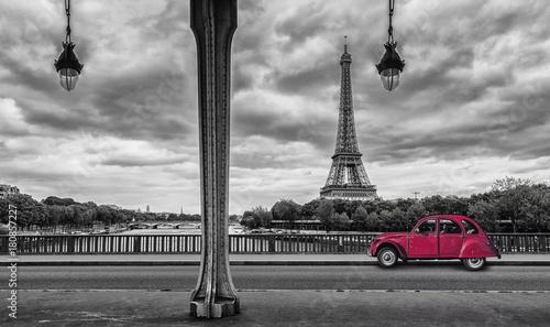 Eiffel Tower with vintage Car in Paris, seen from under the Bir Hakeim Bridge - 180857227