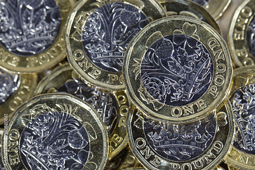British Currency - pile of one pound coins in a horizontal format