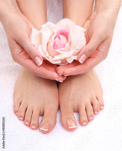 Papiers peints Pedicure Closeup photo of a beautiful female feet with pedicure