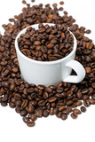 cup with coffee beans on white background, vertical