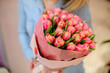 Woman holding a beautiful and tender bouquet of pink tulips - 180888882