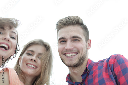 closeup of three young people smiling on white background - 180893409