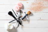 Concept of cosmetics and makeup with powder, skincare and brushes - 180901448