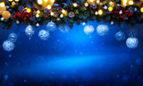 art Christmas holiday decoration; Fir tree Branches and holiday light on blue snowy background - 180904093