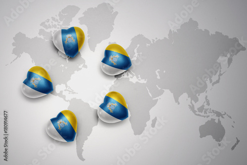 Papiers peints Iles Canaries five hearts with national flag of canary islands on a world map background.