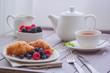 European breakfast tea coffee milk croissant fresh berries morning