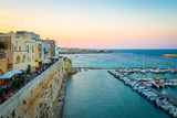 OTRANTO, ITALY - AUGUST 23, 2017 - panoramic view from the old town at sunset during turistic season - 180930011