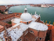 Looking down on the domed rooftop of San Giorgio Maggiore with Doges Palace and San Marcos Square in the background