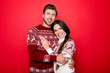Celebrate winter feast! X mas noel. Adorable sweet caucasian couple bonding, so excited in knitted cute traditional x mas costumes with ornament, cuddle, enjoy, lady has a toothy grin