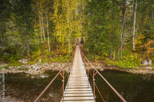 Wooden bridge above the river