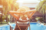 summer holidays, woman in luxurious hotel - 180950850