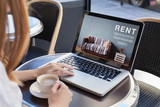 rent online concept, woman using internet website for rental apartments, houses and flats - 180952657