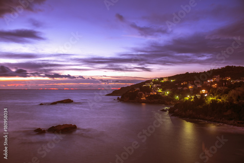 Foto op Canvas Zee zonsondergang Montenegro, city of Ulcinj, the view of the sunset on the Adriatic sea in the storm with the old fortress, the month of October.