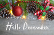 Hello December.Christmas decoration on old wooden background.Winter holidays concept.Selective focus.
