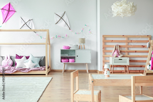 Cozy girl's bedroom with toys