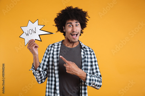 Portrait of an excited happy african man pointing finger