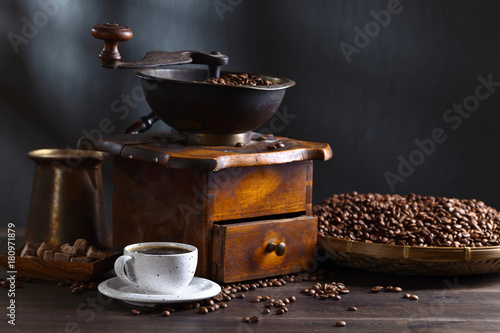 Papiers peints Cafe Cup of black coffee , coffee grinder and roasted beans