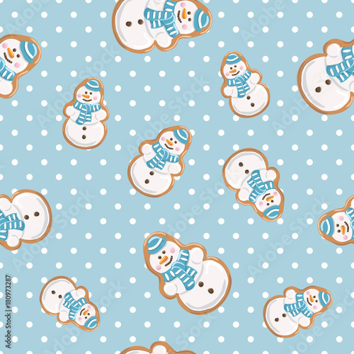 Cotton fabric Ginger cookies seamless pattern. Christmas gingerbread on polka dot blue background .