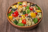 Tabbouleh salad with roasted vegetables, chicken and couscous. Close-up. - 180981849