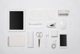 White office supplies. Digital tablet and smartphone on white table background with copy space.