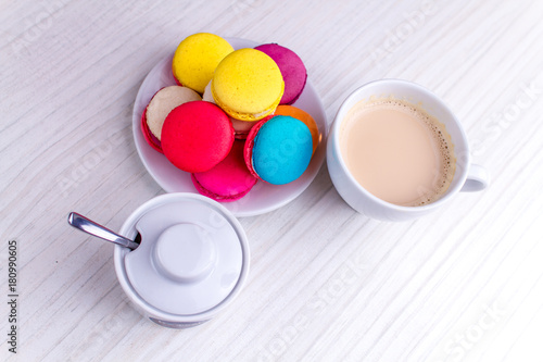 Foto op Aluminium Macarons coffee with milk and with dessert macarons