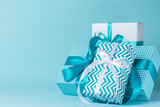 Christmas decorations - colorful presents on blue background - 180995460