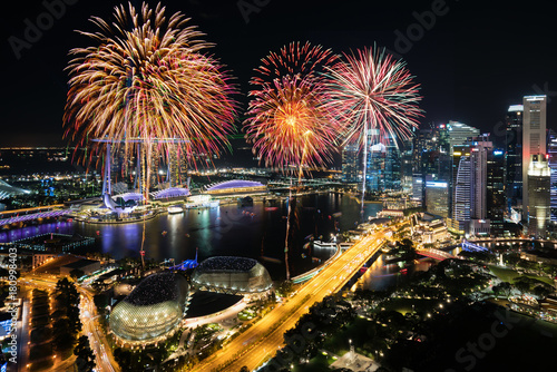 Aerial view of Fireworks celebration over Marina bay in Singapore Poster
