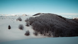 Landscape view of a mountain and dark forest on the Velebit mountain. Winter in Velebit, Croatia, Europe. - 180999273