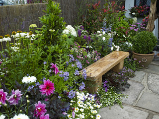 Garden seating in a colorful flower garden