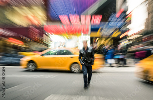 Keuken foto achterwand New York TAXI Radial blur of yellow taxicabs and unidentified person walking on 42nd street crossroad in Manhattan downtown district - Everyday commuting life New York City on rush hour in urban business area