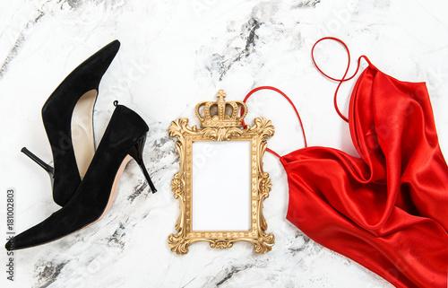 Plakat Fashion flat lay Red dress black high heels golden frame