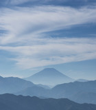 Iconic Mount Fuji wrapped in misty clouds like and old painting, seen from Mount Takao in Japan - 181007413