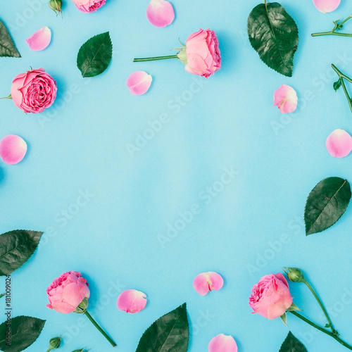 Round frame made of pink roses and green leaves