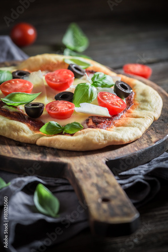 Fototapeta Homemade pizza with tomatoes, basil and cheese