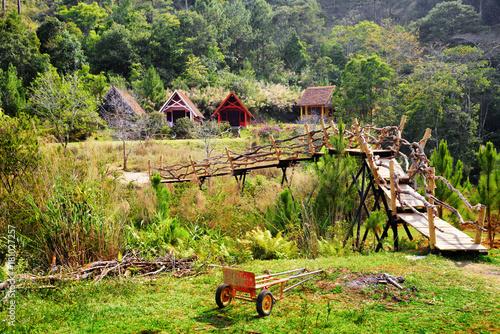 Foto op Canvas Pistache Amazing wooden bridge leading to rustic houses