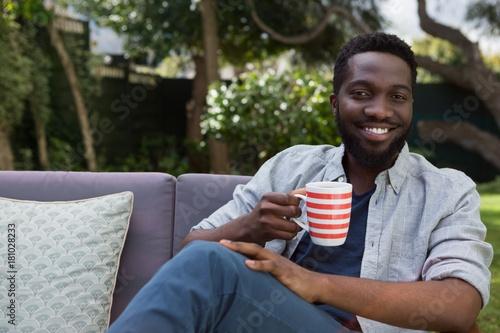 Papiers peints Cafe Man having black coffee in garden