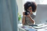 Graphic designer taking picture with digital camera - 181035260