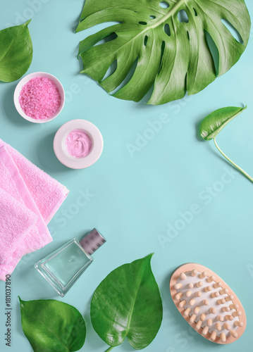 Fototapeta Spa background, flat lay layout with monstera leaves and cosmetic care products
