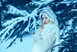 Portrait of a young beautiful woman in white winter forest - 181042853