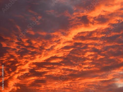 Foto op Canvas Baksteen Beautiful sunset. Golden clouds in the evening sky. The backdrop of an evening sky. Photo.