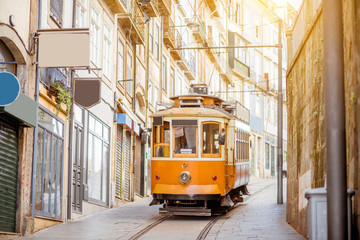 Street view with famous retro tourist tram in the old town of Porto city, Portugal