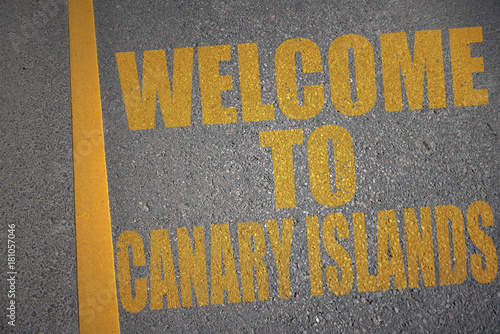 Fotobehang Canarische Eilanden asphalt road with text welcome to canary islands near yellow line.