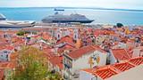 cruise ship behind lisbon houses