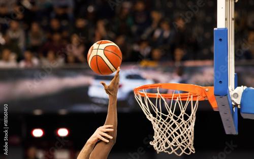scoring during a basketball game - ball in hoop