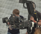 Professional digital video camera. professional camcorder on the shooting of the cityscape. - 181065426