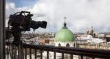 Professional digital video camera. professional camcorder on the shooting of the cityscape. - 181065466