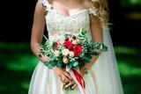 Bride holding big wedding bouquet on wedding ceremony